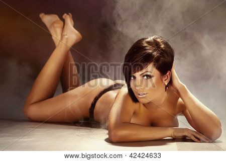 Sexy Tanned Brunette Woman Lying On The Floor, Naked.