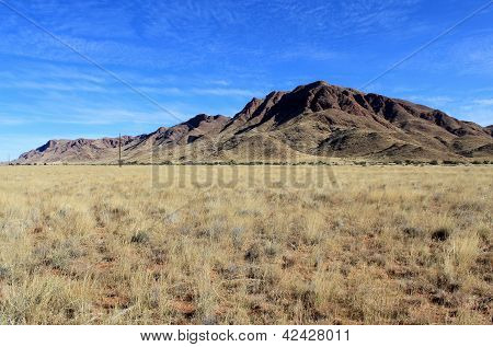 Grassy Savannah With Mountains In Background, Namib Naukluft Park.