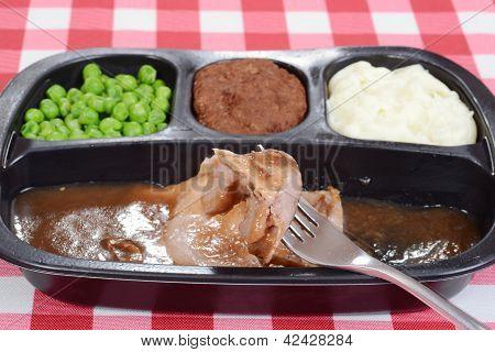 Macro roast beef tv dinner on fork