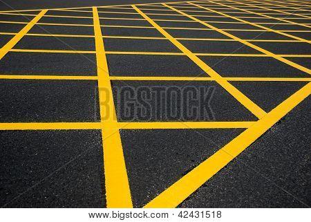 Cross Yellow Lines On Blacktop