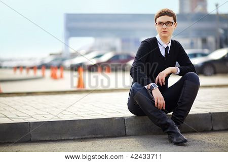 Businesswoman In Glasses Sitting