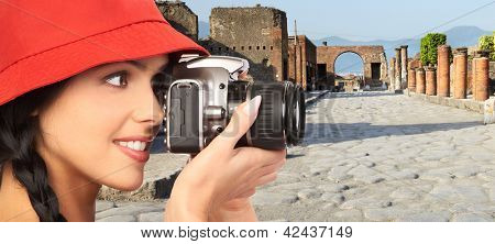 Tourist woman with a camera. Italy vacation.
