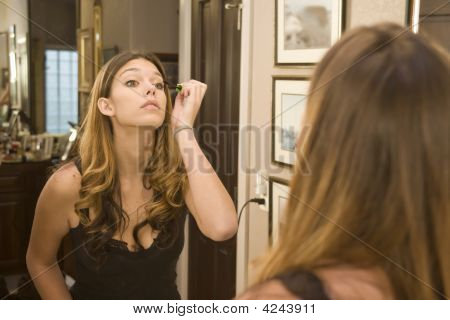 Applying Makeup In The Mirror