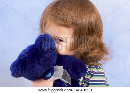 Peek-A-Boo - Child Peeking From Blue Teddy Bear