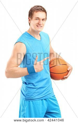 A smiling basketball player holding a ball and gesturing isolated on white background