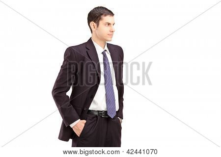 Angry man in suit with hands in pockets shot during an argue isolated on white background