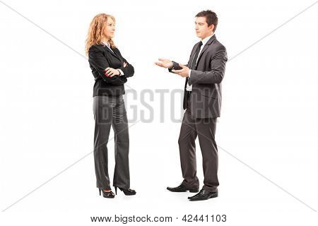 Full length portrait of a professional male and female having a conversation isolated on white background
