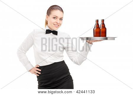 A waitress with bow tie holding a tray with two bottles of beer on it isolated on white background