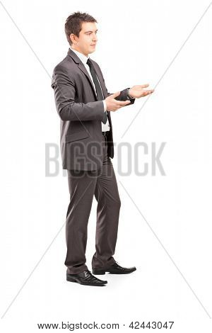 Full length portrait of a professional male shot during a conversation isolated on white backgroun
