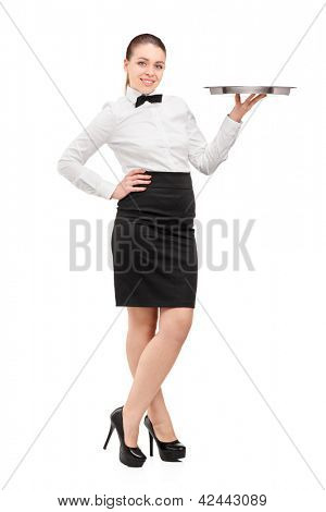 Full length portrait of a waitress with bow tie holding an empty tray isolated on white background