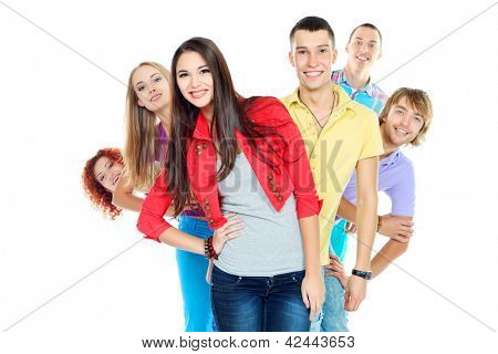 Large group of young people standing together in a row. Friendship. Isolated over white.