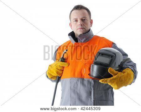 Welder wearing protective suit holding welding hood and gas welding gun on white