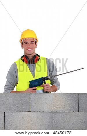 Man using drill with long bit