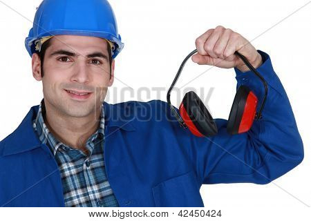 Construction worker with ear defenders