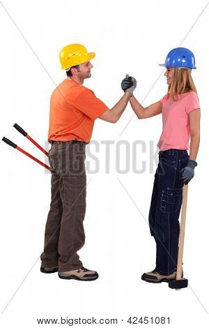 A couple of handyman shaking hands.
