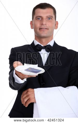 Waiter holding tray with credit card