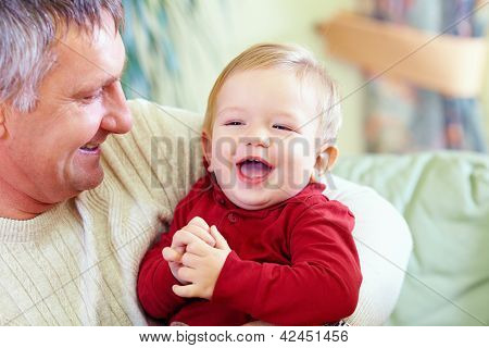 Happy Grandfather With Laughing Grandson, Indoors