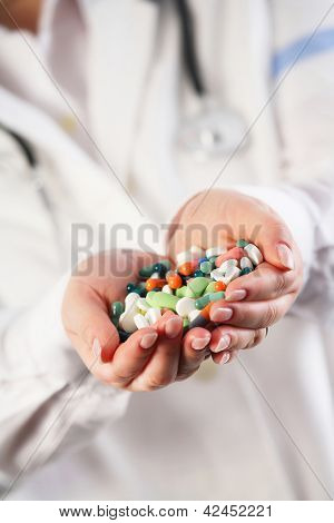 Doctor With Pills In Her Hands
