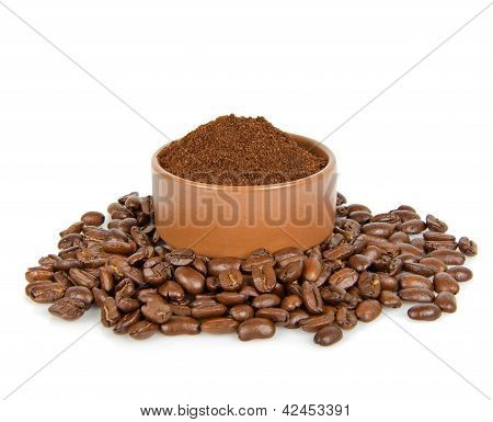 Coffee Bean And Ground Coffee In Bowl