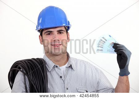 An electrician with his hand full of cash.