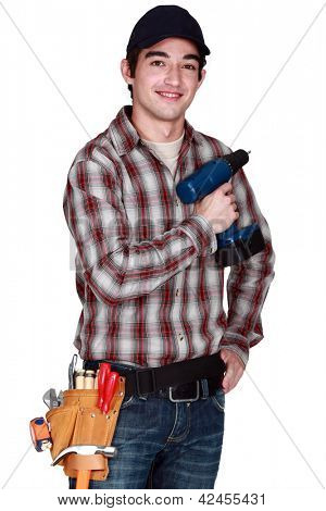 Young man with drill in hand