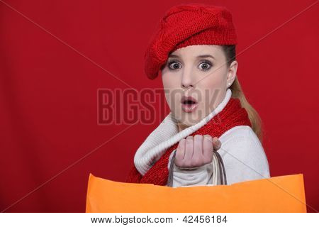 female shopper looks surprised