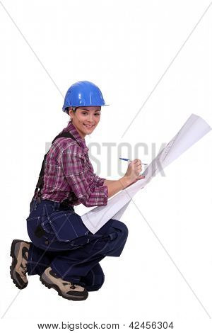 Skilled construction worker amending a blueprint