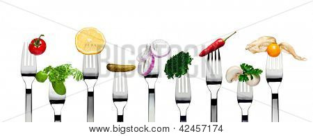 Variety of vegetarian food on forks isolated