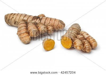 Fresh curcuma root with slices on white background