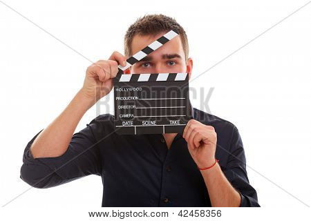 Young guy with clapper board isolated over white background