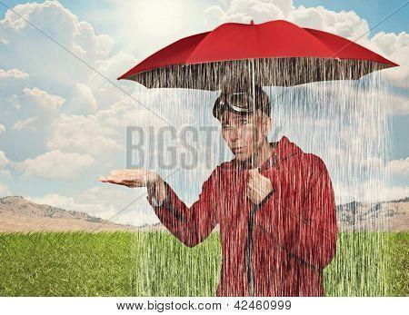 uma menina que pegou em um chuveiro de chuva sob seu guarda-chuva