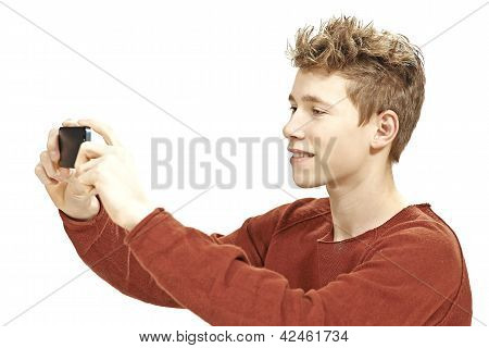 Teen boy photographing