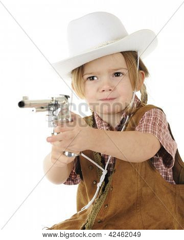 "An adorable preschool cowgirl pointing her cap gun with a stern ""stick 'em up!"" attitude.  White background."