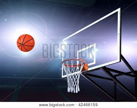 Basket ball heading the hoop with spotlights