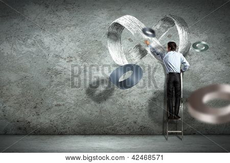 Business man drawing infinity sign