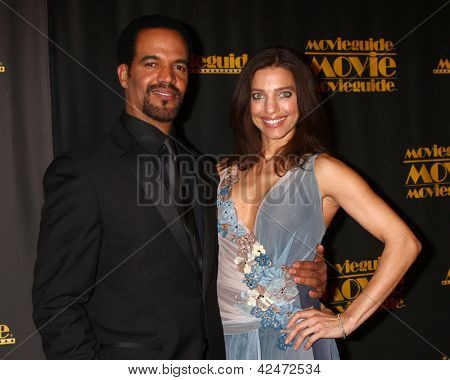 LOS ANGELES - FEB 15:  Kristoff St. John, Dana Derrick arrive at the 2013 MovieGuide Awards at the Universal Hilton Hotel on February 15, 2013 in Los Angeles, CA
