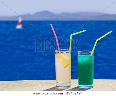 Two Cocktails On Table At Beach