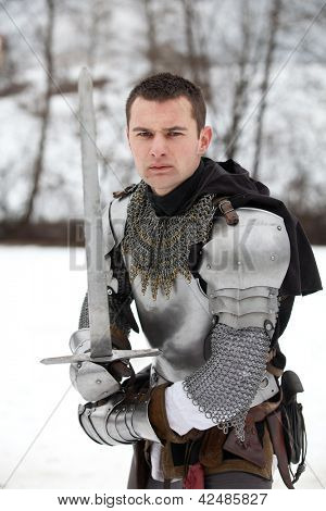 "DONJA STUBICA, CROATIA - FEBRUARY 9: Representation of the Croatian-Slovenian peasant revolt ""Seljacka buna"" of 1573, on February 9, 2013 in Donja Stubica, Croatia. Knight posing with a sword"