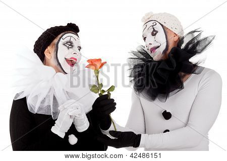 Couple Of Clowns In Love With A Flower