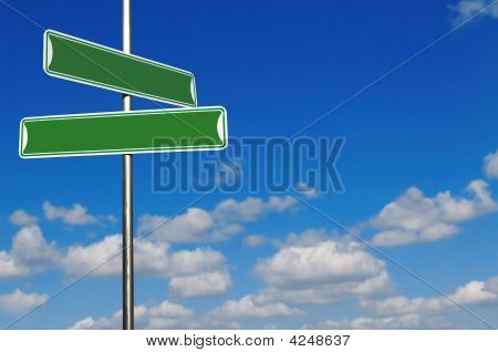 Blank Green Street Name Signs Agains A Bright Blue Sky