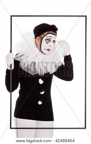 Female Clown In A Frame Is Crying