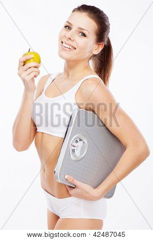 Beautiful slim woman with scales on white background