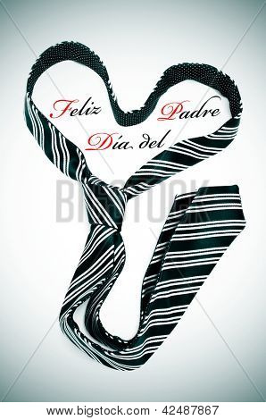 a tie forming a heart and the sentence feliz dia del padre, happy fathers day written in spanish