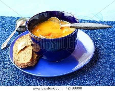 Soup From A Pumpkin And Carrot In Dark Blue A Soup Cup