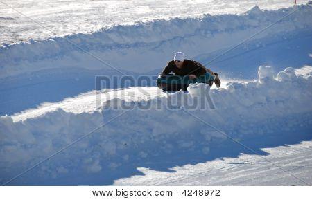 Man Tubing Down The Hill