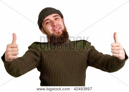Young Guy Showing A Success Sign  Isolated On White Background