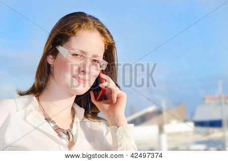 Successful Young Woman Making A Phone Call.