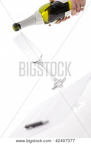 Woman About To Pour Wine Into A Glass