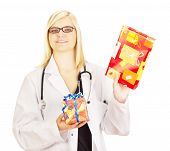 stock photo of lobbyist  - A female medical doctor with two gifts - JPG