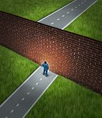 picture of brick block  - Business challenge and financial obstacles concept with a businessman standing in front of a large brick wall that has blocked his path and obstructed a journey to success - JPG
